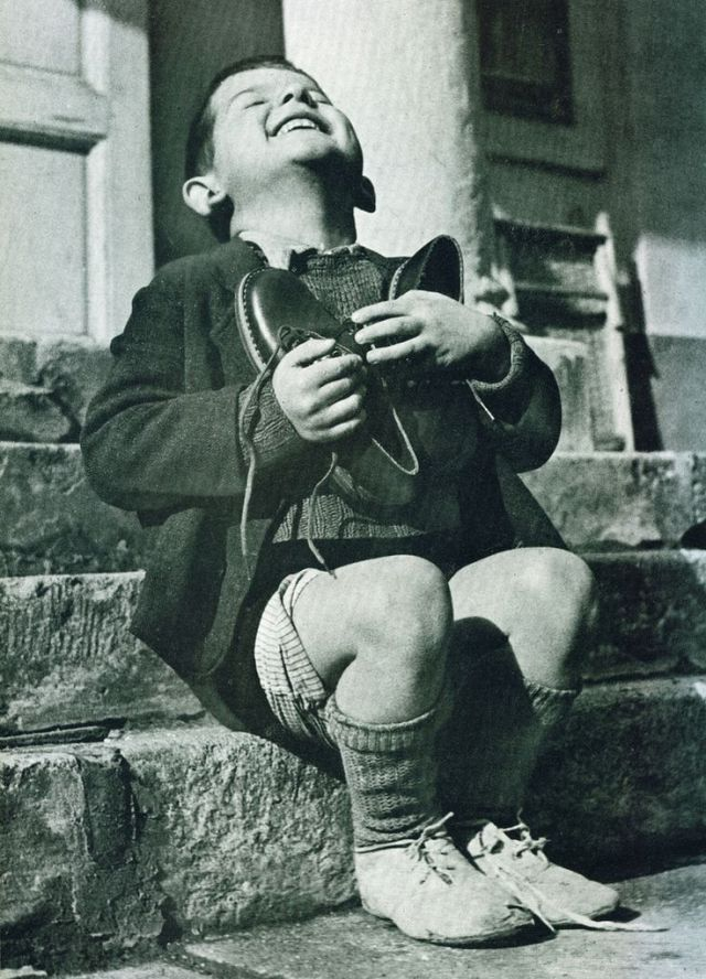 1946 issue of Life magazine. Werfel, a six-year-old Austrian orphan, has just received his first new pair of shoes as part of the post-war relief effort of the American Red Cross.