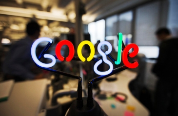 A neon Google logo is seen at the new Google office in Toronto, November 13, 2012. REUTERS/Mark Blinch (CANADA - Tags: SCIENCE TECHNOLOGY BUSINESS LOGO)